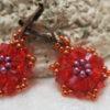 Image of earring star in light red