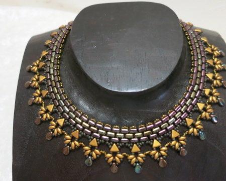 necklace in aztek style brown golden