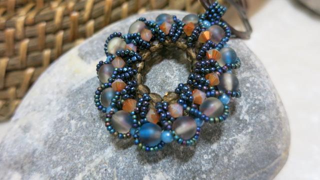 pendant in brown blue top