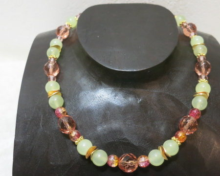 image of gemstone necklace on wooden display
