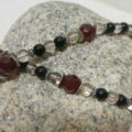 necklace with red and black beads in eight form