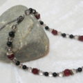 necklace with red and black beads lateral