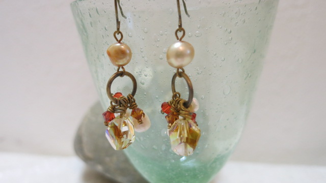 earring with hanging beads on glass