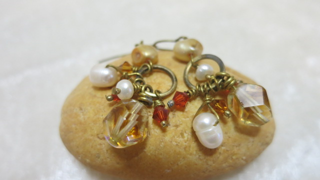 earring with hanging beads on stone