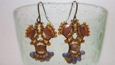 earring rose natural coloured hanging near