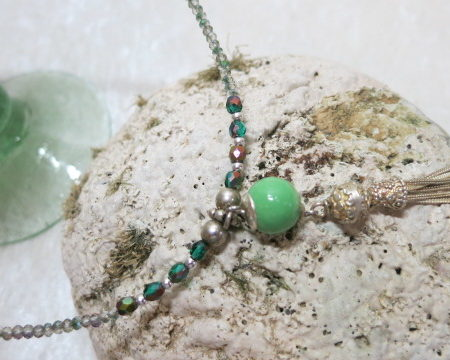 Long necklace green with tassel pendant on stone