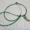 Long necklace green with tassel pendant laying