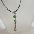 Long necklace green with tassel pendant on bust