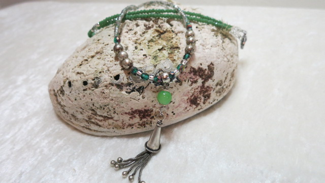 Long necklace green with cone tassel on stone