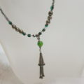 Long necklace green with cone tassel