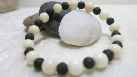bracelet white coral with black lava laying