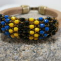 Leather bangle with netted beads front in detail