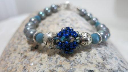 bracelet grey with beaded pearl