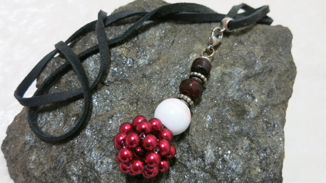 netted bead pendant red on stone