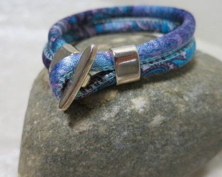 cord bracelet in blue on stone