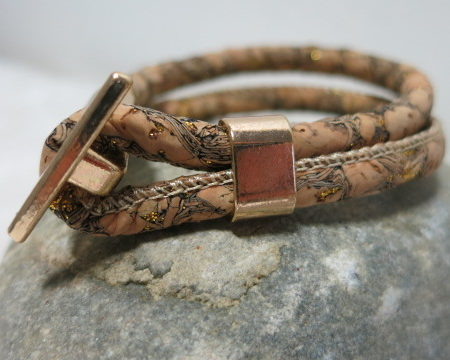 cord bracelet light brown laying