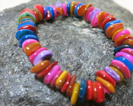 bracelet with colorful shellbeads on stone