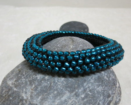 bracelet rolled crochet style petrol laying