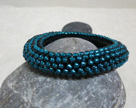 bracelet rolled crochet style petrol laying