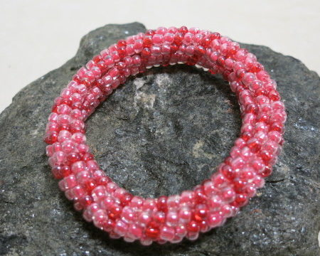 bracelet in red and pink colors crochet style