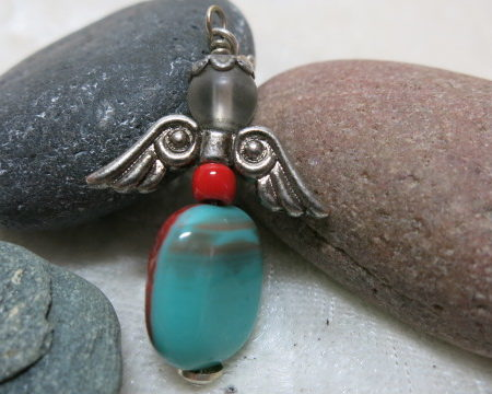 angel turquoise red colored