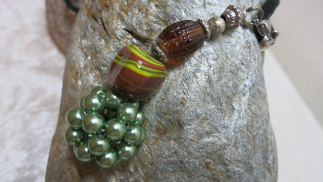 necklace long green brown netted pendant detailed