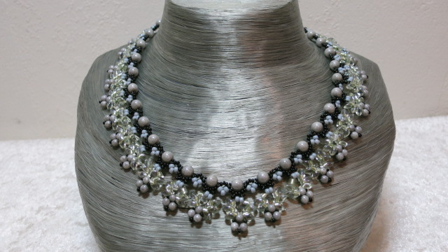 necklace limegreen with black and grey color on grey bust