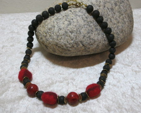 necklace with coral lava and felted red beads laying