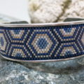 bracelet open bangle ethno pattern in blue and silver colors on black stone