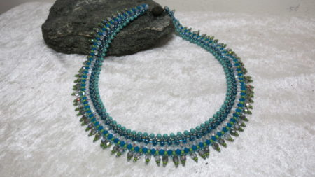 necklace collier turquoise color with african lookahead black stone laying