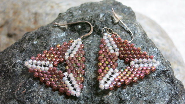 earring pink white triangle near view