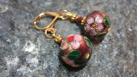 earring brown red laying on stone