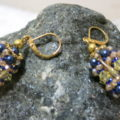 earring pendant in golden and blue colors on stone