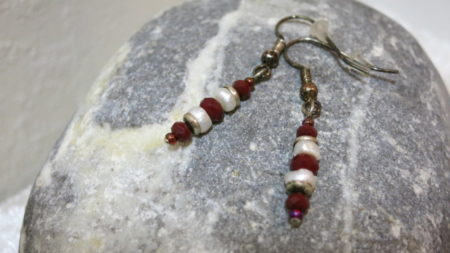earring long pendant freshwater pearl with red faceted beads laying