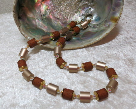 necklace aluminium golden brown barrel with swarowski bicones ahead shell