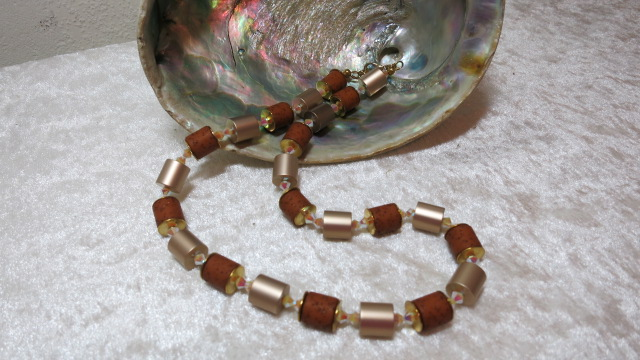 necklace aluminium golden brown barrel with swarowski bicones ahead shell