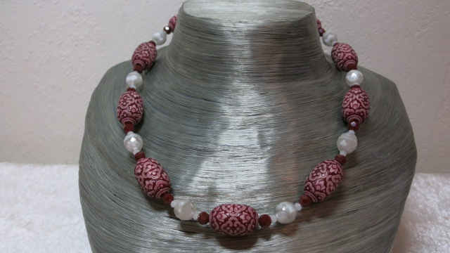 necklace with patterned beads red colored and white beads