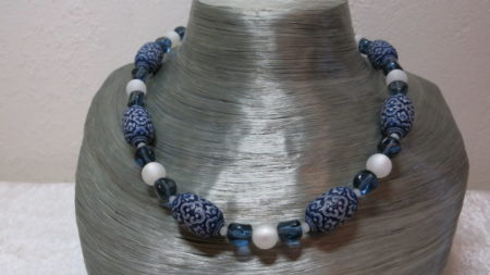 necklace blue patterned beads and white beads on silverbust