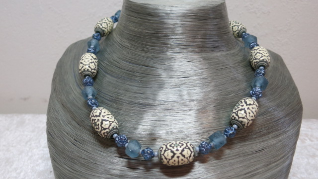 necklace patterned beads creamy color with light blue on silverbust