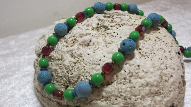 necklace with turquoise lava and green and red beads on shell