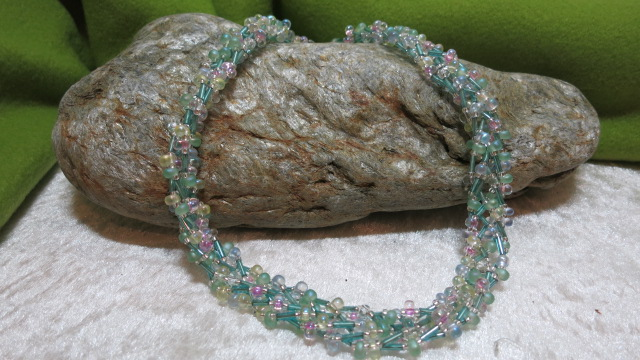 braided necklace pastelshaded blue with pink ahead stone