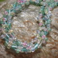 braided necklace pastelshaded blue with pink near view