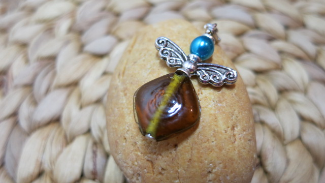 guardian angel amber brown turquoise blue on yellow stone