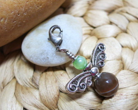 guardian angel brown green small ahead white stone