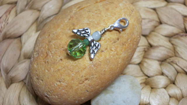guardian angel faceted green small opaque white on yellow stone
