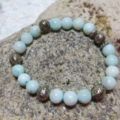 bracelet mint colored silvery beads on elastic on stone