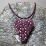 pendant heart pinkcolors threaded with leather tape on silver stone