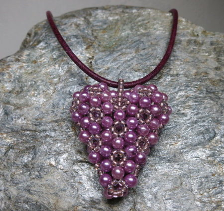 pendant heart pinkcolors threaded with leather tape front view