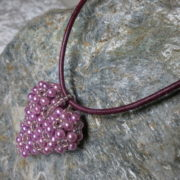 pendant heart pinkcolors threaded with leather tape view from above