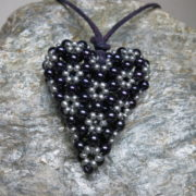 pendant heart purple grey colors threaded with leather tape on silver stone